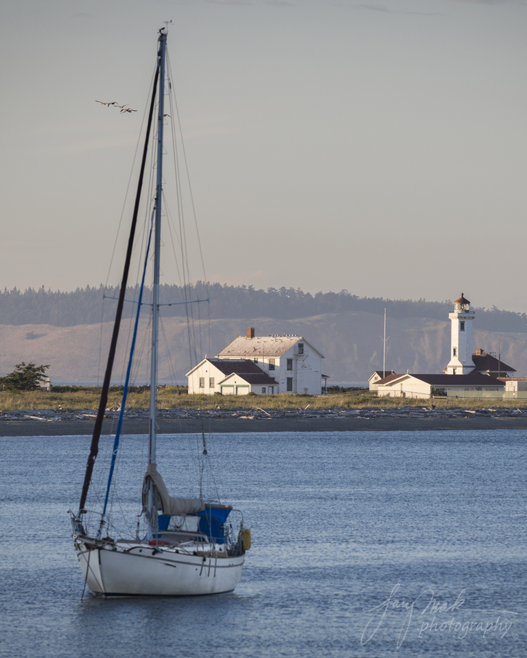 Fort Worden Wilson Lighthouse at Sunset with boat