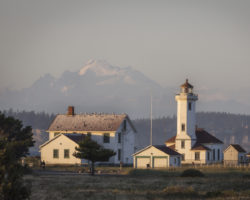 Fort Worden Wilson Lighthouse at Sunset with Mountain Peak